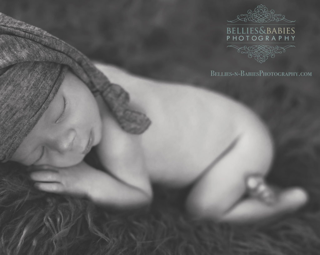 Newborn baby boy in knit sleepy hat