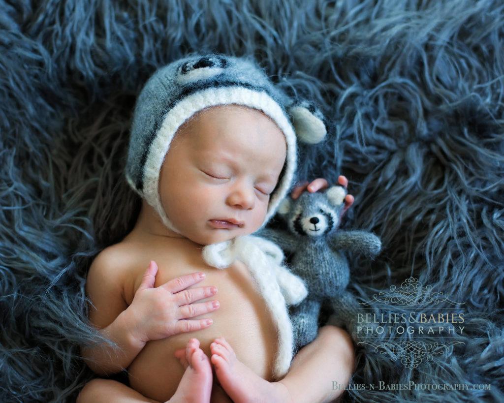 Newborn baby with vastoys knit panda bear
