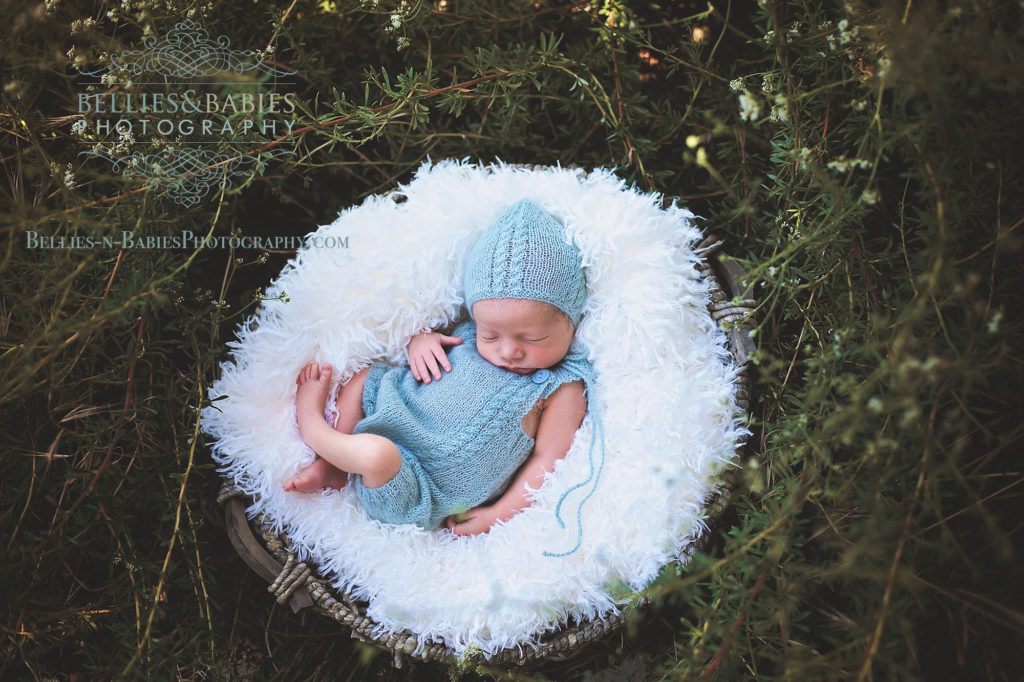 Newborn baby in basket outdoors, nest